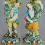 Boy and girl cornucopia vases