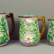 George Jones wild rose pitchers in graduated sizes