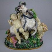 Minton goat and putti figure