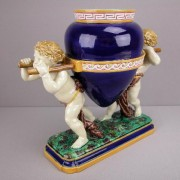 Minton putti with urn table center