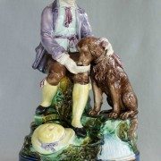 Boy feeding dog figure