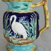 Stork in marsh pitcher with bamboo handle