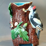 Woodpecker and butterfly vase