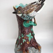 Bird on trunk walking stick stand